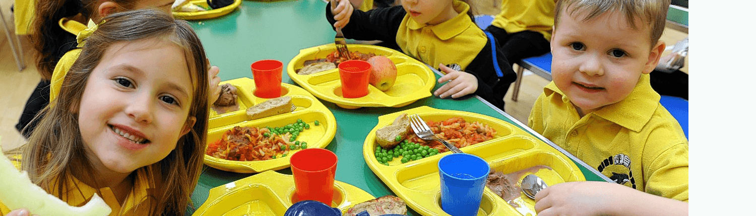 Children eating Eat Balanced healthy pizza at school