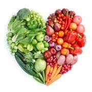 A heart image showing healthy fruit and vegetables as part of a balanced diet.